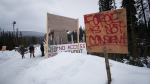 A checkpoint is seen at a bridge leading to the Unist'ot'en camp on a remote logging road near Houston, B.C., Thursday, Jan. 17, 2019. (Darryl Dyck / The Canadian Press)