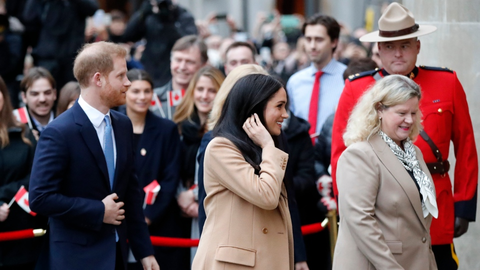 Prince Harry and Meghan, Duchess of Sussex arrive at Canada House in London, Tuesday Jan. 7, 2020, after their recent stay in Canada. (AP Photo/Frank Augstein)