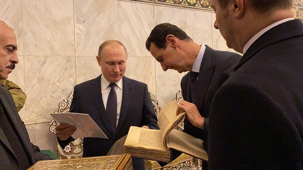 Vladimir Putin, centre, and Bashar Assad