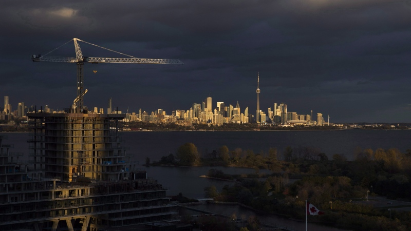 Condominiums are seen under construction in front of the skyline in Toronto, Ont., on Tuesday October 31, 2017. THE CANADIAN PRESS/Mark Blinch