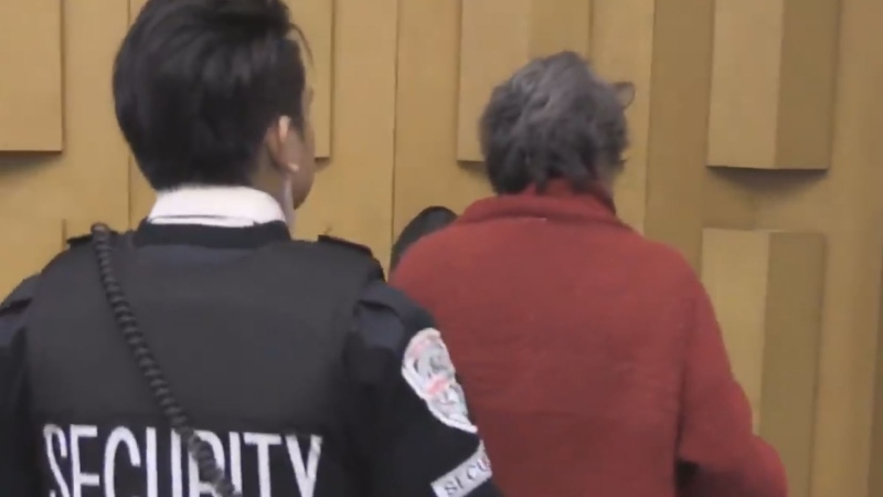 Anna Maria Valastro is escorted from a meeting in city council chambers  in London, Ont. on Tuesday, Jan. 7, 2020. (Daryl Newcombe / CTV London)