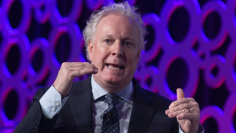 Jean Charest speaks during a panel discussion at the Canadian Aerospace Summit in Ottawa, Wednesday, Nov. 13, 2019. (THE CANADIAN PRESS / Adrian Wyld)