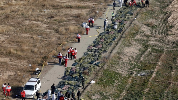 Bodies of the victims of a Ukrainian plane crash are collected by rescue team at the scene of the crash in Shahedshahr, southwest of the capital Tehran, Iran, Wednesday, Jan. 8, 2020. (AP Photo/Ebrahim Noroozi)