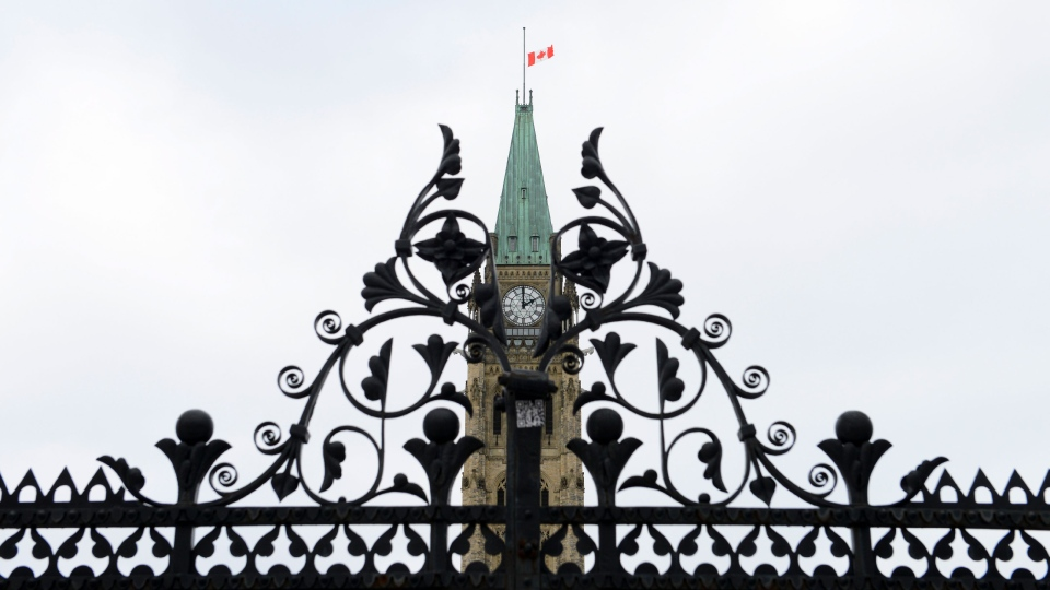 The Parliament Hill Peace Tower flag at half-mast