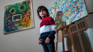 Mikail Akar, 7, has taken the German art world by storm. (AFP)