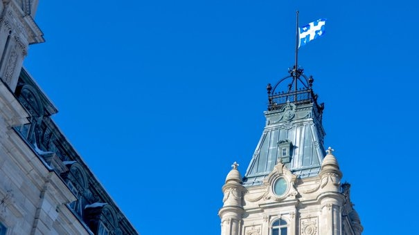 Quebec's flag flying at half-staff at the National Assembly in Quebec City. (File photo)