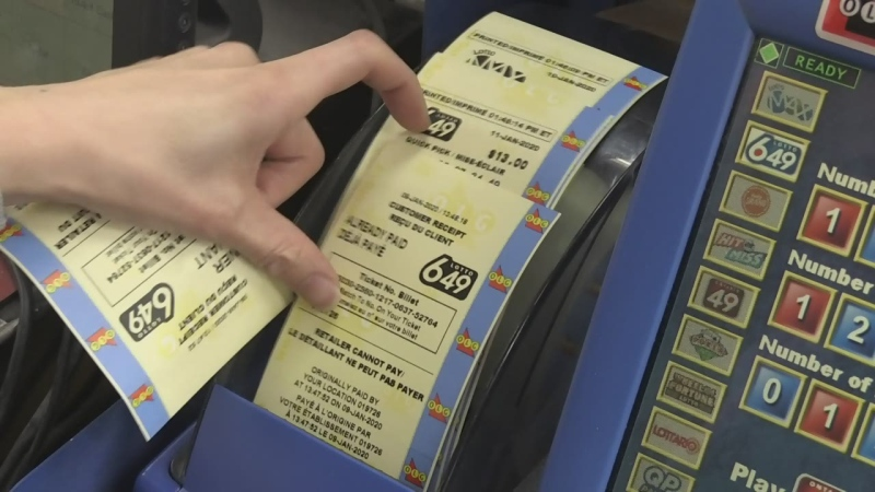 An undated file photo of a person buying Lotto 6/49 tickets.