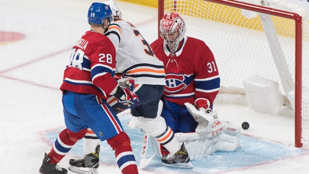 Montreal Canadiens goaltender Carey Price is scored on by Edmonton Oilers' Ryan Nugent-Hopkins as Oilers' Alex Chiasson and Canadiens' Marco Scandella look for a rebound during third period NHL hockey action in Montreal, Thursday, January 9, 2020. THE CANADIAN PRESS/Graham Hughes