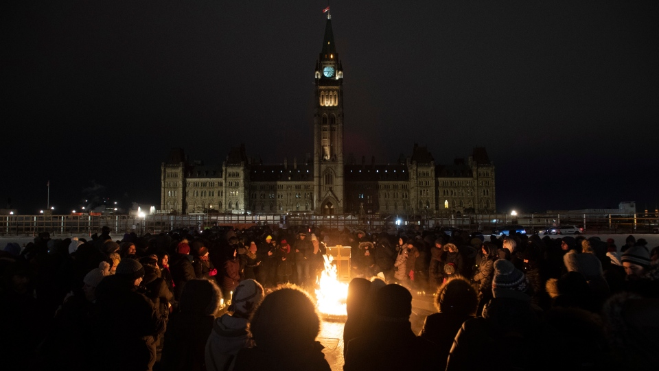 Several hundred people gather around the Centennial flame for a candle light vigil to remember those killed on Ukraine International Airlines Flight on Thursday January 9, 2020 in Ottawa. THE CANADIAN PRESS/Adrian Wyld