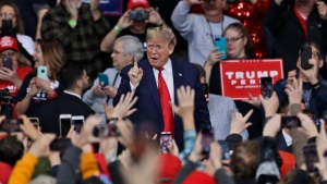 U.S. President Donald Trump acknowledges his supporters before speaking during a campaign rally at the Huntington Center, Thursday, Jan. 9, 2020, in Toledo, Ohio. (AP Photo/Tony Dejak)