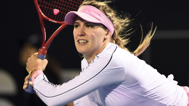 Canada's Eugenie Bouchard makes a return during her first round singles match against Belgium's Kirsten Flipkens at the ASB Classic in Auckland, New Zealand, Monday, Jan. 6, 2020. (Chris Symes/Photosport via AP)