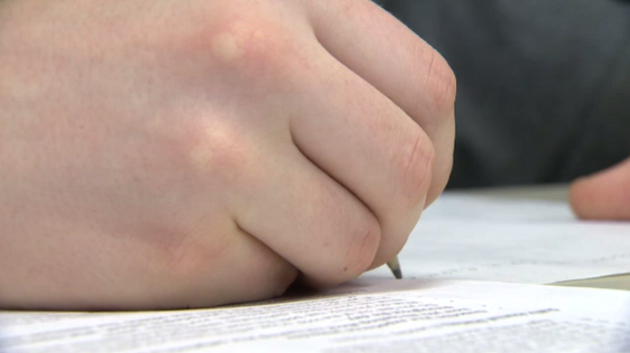 Grade 9 standardized math tests could be postponed due to teachers' work to rule campaign.