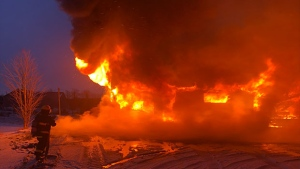 Fire rages through a home in Grey Highlands, one person escaped but one person is feared to have been trapped inside the burning inferno on Jan. 9, 2020. (Grey Highlands Fire and Emergency Service)