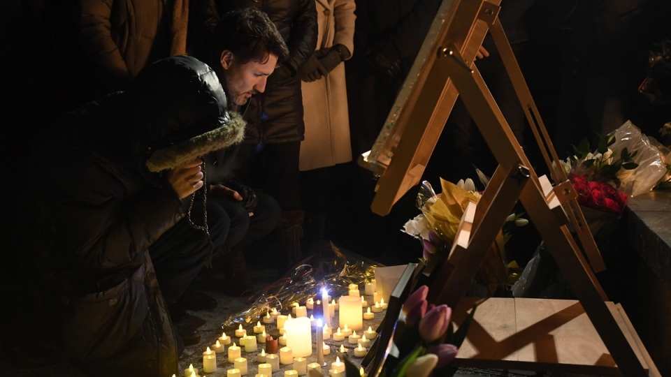 Prime Minister Justin Trudeau attends a candlelight vigil for victims of the Ukraine International Airlines crash in Tehran, on Jan. 9, 2020. (Adrian Wyld / THE CANADIAN PRESS)