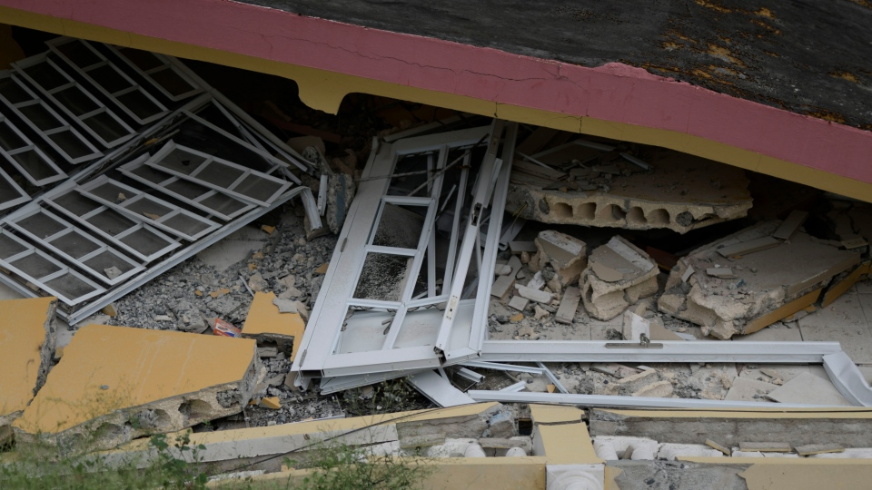 A collapsed structure lies after a Jan. 7, 2020 magnitude 6.4 earthquake in Yauco, Puerto Rico. Another quake hit the area on Saturday, causing further damage. (AP Photo/Carlos Giusti)