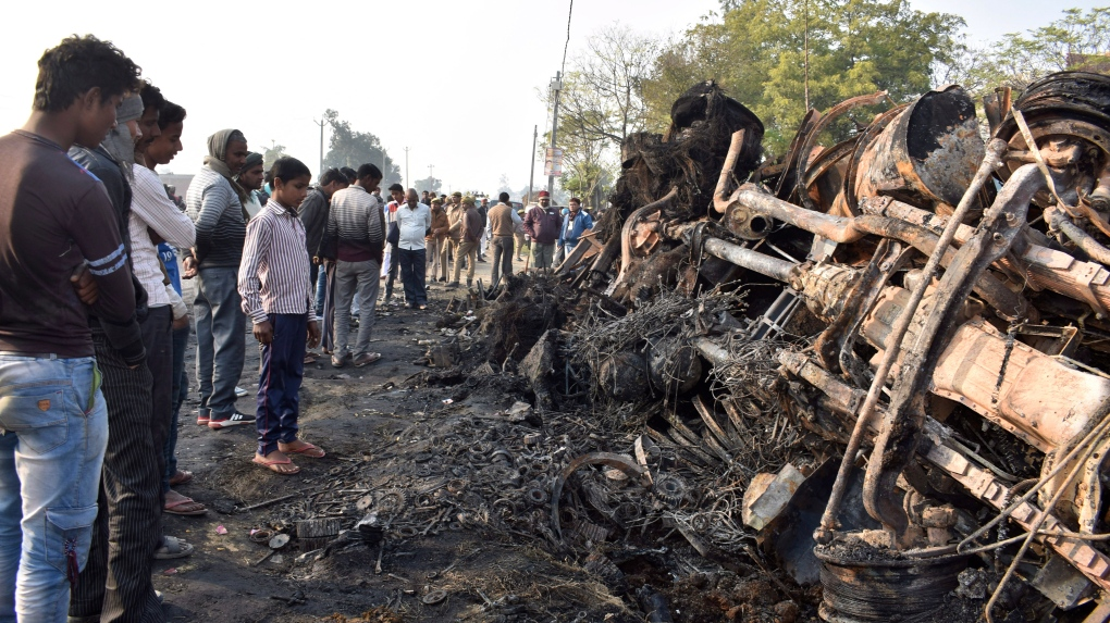 Bus catches fire in road accident in India; at least 20 dead