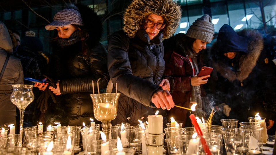 Members of Montreal's Iranian community attend a vigil in downtown Montreal on Thursday January 9, 2020, to mourn victims of the Iranian air crash. THE CANADIAN PRESS/Andrej Ivanov