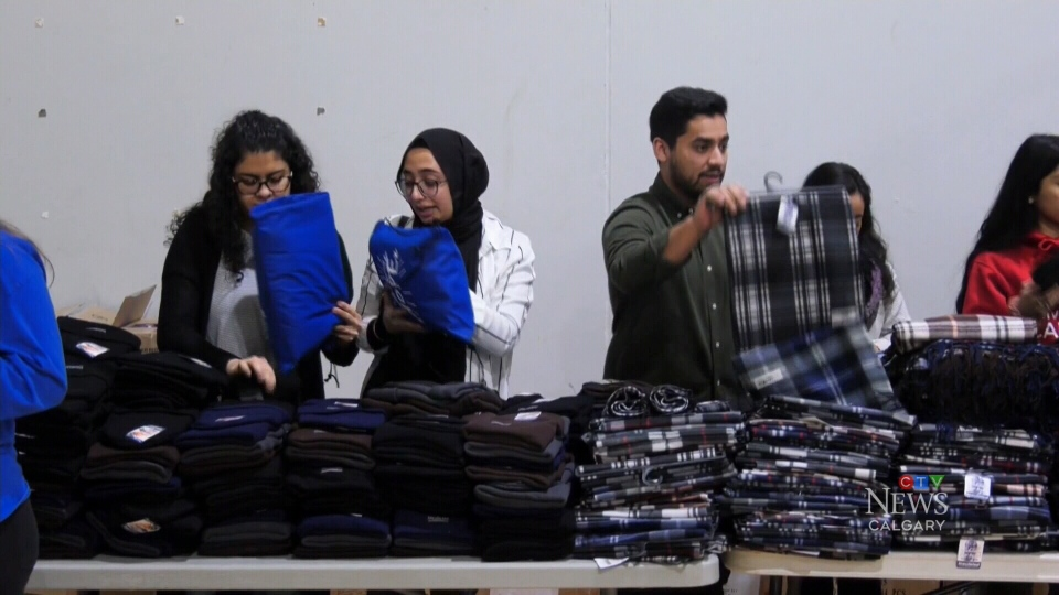 Volunteers at Islamic Relief Canada pack bags of items that will help homeless manage the cold temperatures.