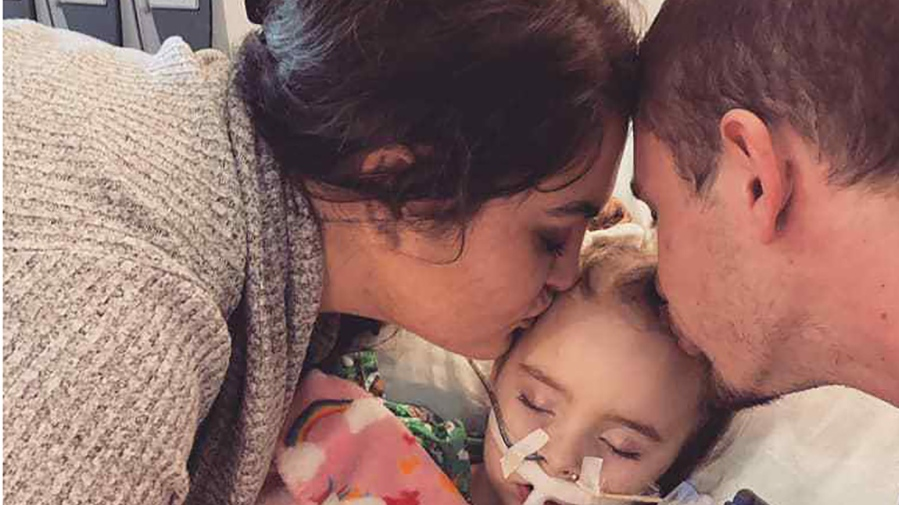Amanda Phillips and Stephen DeLucia with their daughter, Jade DeLucia, at the University of Iowa Stead Family Children's Hospital. (Amanda Phillips/Facebook)