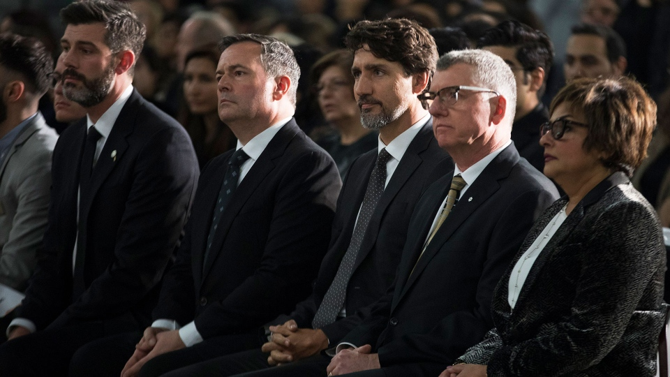 Edmonton Mayor Don Iveson, Alberta Premier Jason Kenney, Prime Minister Justin Trudeau and University of Alberta President David Turpin listens to speeches during a memorial for the victims of the Ukrainian plane disaster in Iran this past week in Edmonton, Sunday, Jan. 12, 2020.THE CANADIAN PRESS/Todd Korol