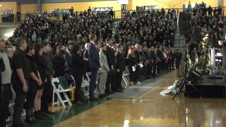 The crowd of thousands at the Saville Community Sports Centre at the University of Alberta on Jan. 12, 2020, stands for Canda's national anthem.