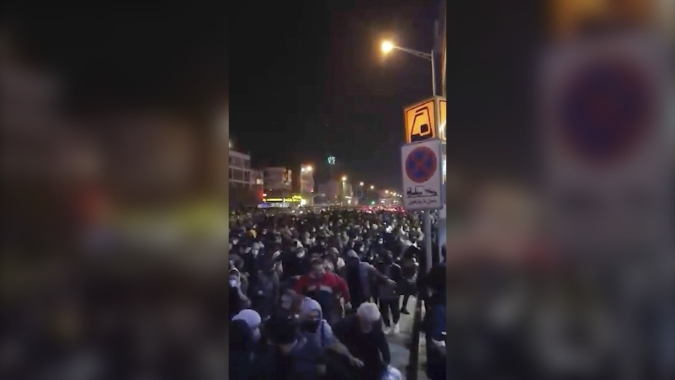 This image from a Sunday, Jan. 12, 2020 video provided by the New York-based Center for Human Rights in Iran shows a crowd fleeing police near Azadi, or Freedom, Square in Tehran, Iran. Center for Human Rights in Iran via AP)