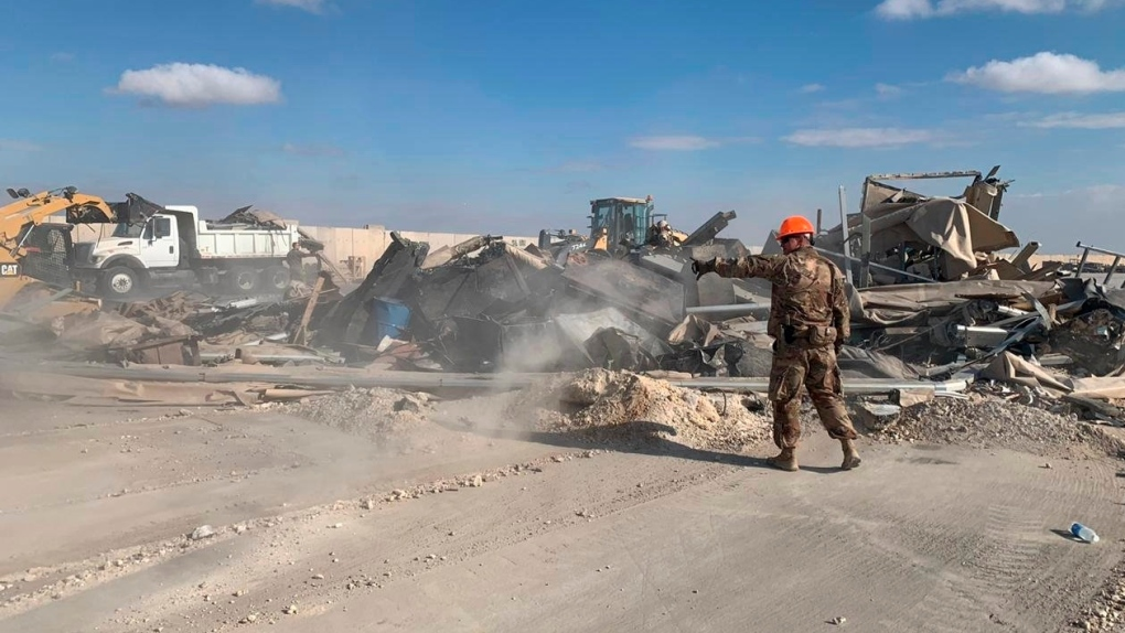 Soldiers clear rubble