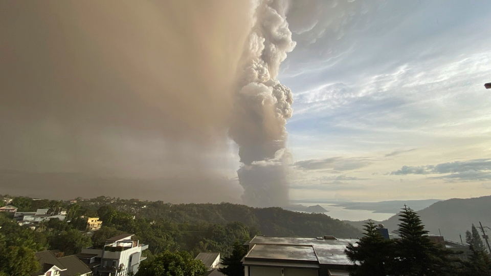 In this Jan. 12, 2020, photo, plumes of smoke and ash rise from as Taal Volcano erupts in Tagaytay, Cavite province, outside Manila, Philippines (AP Photo/Aaron Favila)