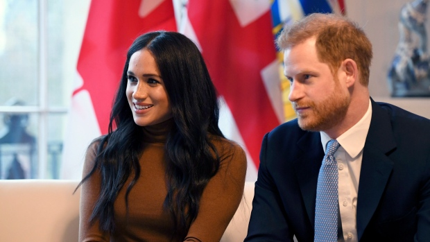 In this Tuesday, Jan. 7, 2020 file photo, Prince Harry and Meghan, Duchess of Sussex smile during their visit to Canada House, in London. (Daniel Leal-Olivas/Pool Photo via AP)