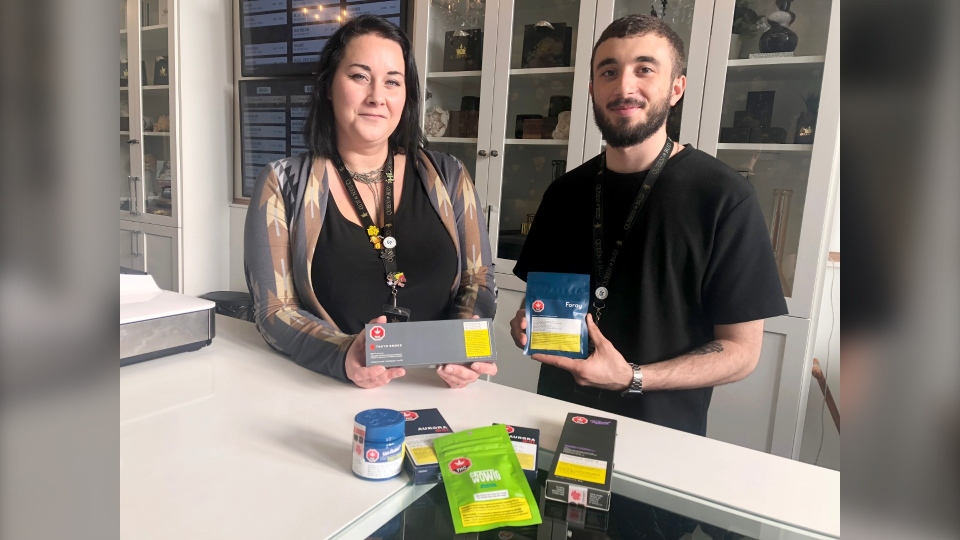 Queen of Bud associates Renee Hamilton, and Adam Chammoury, show some of the cannabis edibles that will be available starting Monday afternoon.