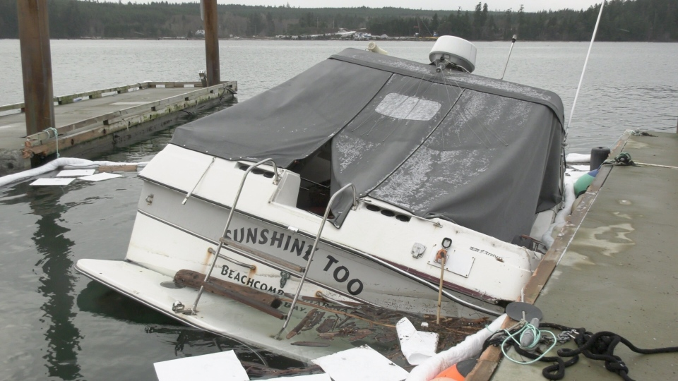 A damaged boat that was docked at the Beachcomber Marina in Nanoose Bay is pictured following this weekend's storm: Jan. 13, 2020 (CTV News)