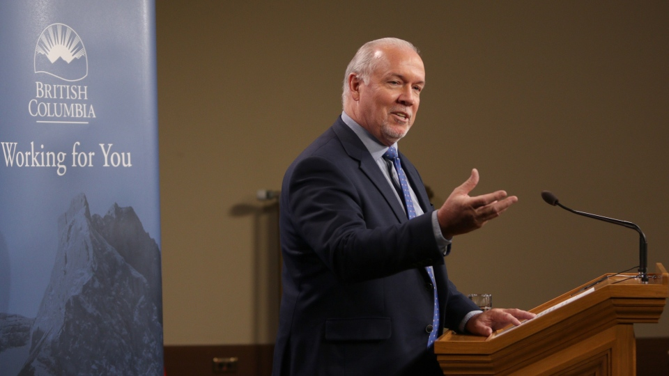 Premier John Horgan holds a press conference in the Press Gallery of the B.C. Legislature in Victoria, B.C., on Monday, January 13, 2020. THE CANADIAN PRESS/Chad Hipolito