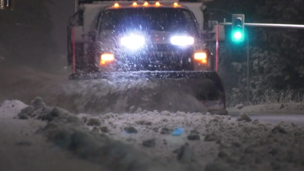 A snow plow works to clear the roads after a January 2020 snowfall in Metro Vancouver.