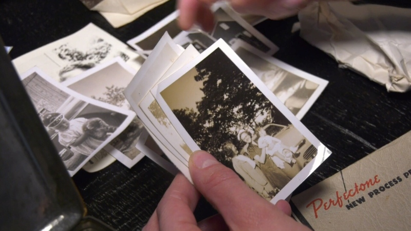 Jessica Lucas sorts through about 100 photographs she found in the attic of her new home.