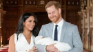 "FILE - In this Wednesday May 8, 2019 file photo, Prince Harry and Meghan, Duchess of Sussex, during a photocall with their newborn son Archie, in St George's Hall at Windsor Castle, Windsor, south England. In a stunning declaration, Britain's Prince Harry and his wife, Meghan, said they are planning ""to step back"" as senior members of the royal family and ""work to become financially independent."" A statement issued by the couple Wednesday, Jan. 8, 2020 also said they intend to ""balance"" their time between the U.K. and North America (Dominic Lipinski/Pool via AP, file)"