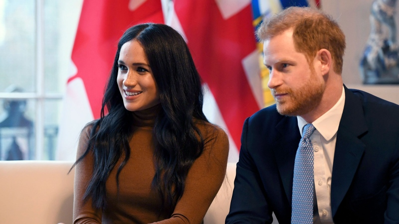 In this Tuesday, Jan. 7, 2020 file photo, Prince Harry and Meghan, Duchess of Sussex smile during their visit to Canada House, in London. Prince Harry and his wife Meghan 'stepping back' as senior UK royals, will work to become financially independent, they announced Wednesday, Jan. 8, 2020.(Daniel Leal-Olivas/Pool Photo via AP, file)