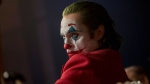 This image released by Warner Bros. Pictures shows Joaquin Phoenix in a scene from 'Joker.' On Monday, Jan. 13, Phoenix was nominated for an Oscar for best actor for his role in the film. (Niko Tavernise/Warner Bros. Pictures via AP)