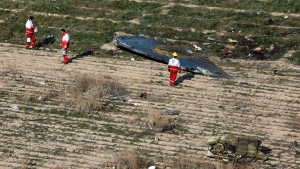 In this Wednesday, Jan. 8, 2020 photo, rescue workers search the scene where a Ukrainian plane crashed in Shahedshahr, southwest of the capital Tehran, Iran. THE CANADIAN PRESS/AP-Ebrahim Noroozi