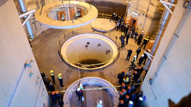 "In this Dec. 23, 2019 file photo released by the Atomic Energy Organization of Iran, technicians work at the Arak heavy water reactor's secondary circuit, as officials and media visit the site, near Arak, Iran. The landmark 2015 deal between Tehran and world powers meant to prevent Iran from obtaining nuclear weapons has been teetering on the edge of collapse since the U.S. pulled unilaterally in 2018. The EU said Wednesday, Jan. 8, 2020, that it will ""spare no effort"" to keep the deal alive, but with tensions between the U.S. escalating into open hostilities it's seeming increasingly unlikely that will be possible. (Atomic Energy Organization of Iran via AP, File)"