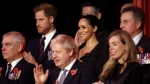 Prince Harry, background left and Meghan, the Duchess of Sussex attend the annual Royal British Legion Festival of Remembrance, at the Royal Albert Hall in Kensington, London, Saturday, Nov. 9, 2019.  In the front row is Prince Andrew, Britain's Prime Minister Boris Johnson and Carrie Symonds. (Chris Jackson/Pool Photo via AP)