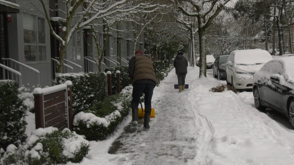 Metro Vancouver residents shoveling snow on Jan. 13, 2020.