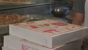 Pizza boxes are seen in this file photo.