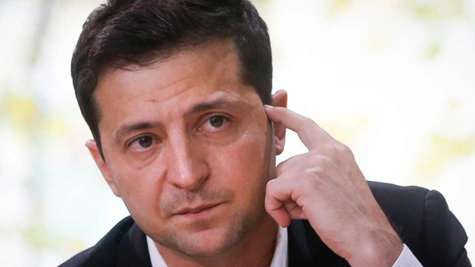 In this file photo taken on Thursday, Oct. 10, 2019, Ukrainian President Volodymyr Zelenskiy attends his long time talks with journalists in Kyiv, Ukraine. (AP Photo/Efrem Lukatsky, File)