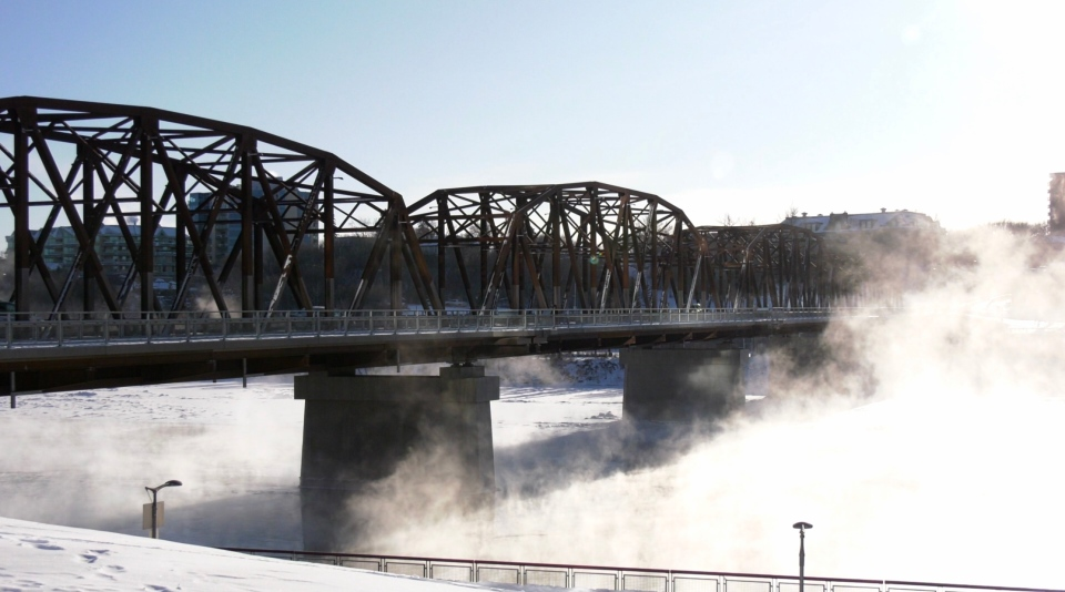 Broadway Bridge as steam rises from the South Saskatchewan River.