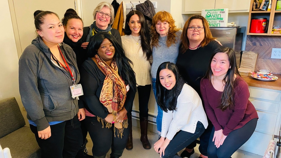 Meghan Markle, centre, poses with a group at the Downtown Eastside Women's Centre on Tuesday, Jan. 14, 2019. (Facebook/Downtown Eastside Women's Centre)
