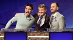 "In this image released by ABC, contestants, from left, James Holzhauer, Ken Jennings and Brad Rutter appear on the set of ""Jeopardy! The Greatest of All Time,"" in Los Angeles. The all-time top ""Jeopardy!"" money winners; Rutter, Jennings and Holzhauer, will compete in a rare prime-time edition of the TV quiz show which will air on consecutive nights beginning 8 p.m. EDT Tuesday. (Eric McCandless/ABC via AP)"