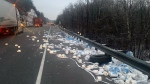 Rolls of toilet paper are seen scattered across Highway 401 just east of the Thousand Islands Bridge after a crash involving two transport trucks on Wednesday, Jan. 15, 2020. (@OPP_ER/Twitter)