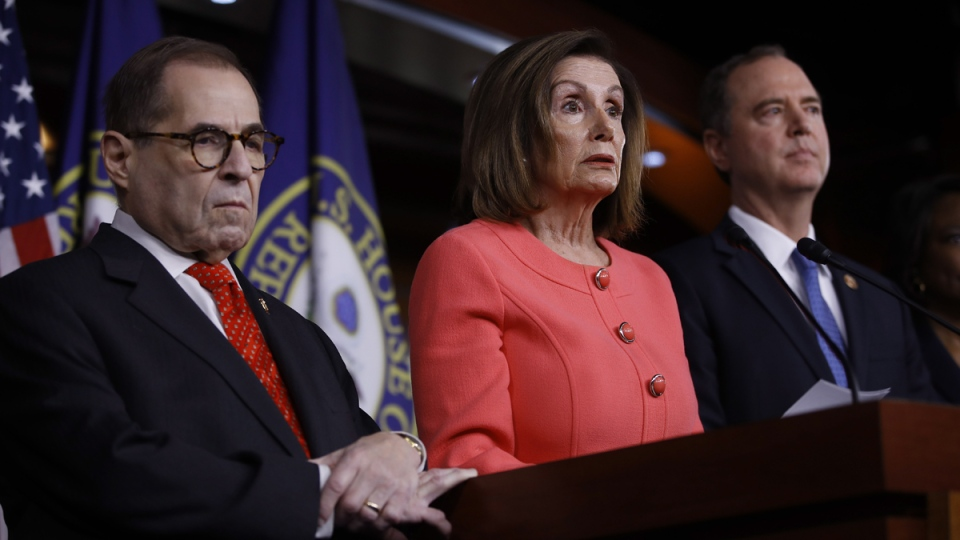 House Speaker Nancy Pelosi of Calif., speaks during a news conference to announce impeachment managers on Capitol Hill in Washington, Wednesday, Jan. 15, 2020. Pelosi is joined by impeachment managers, House Intelligence Committee Chairman Adam Schiff, D-Calif., right, and House Judiciary Committee, Rep. Jerrold Nadler, D-N.Y., left. (Matt Rourke / AP)