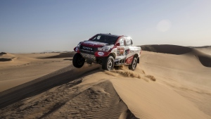 Driver Fernando Alonso, of Spain, and co-driver Marc Coma, of Spain, race their Toyota during stage eight of the Dakar Rally in Wadi Al Dawasir, Saudi Arabia, on Jan. 13, 2020. (Bernat Armangue / AP)