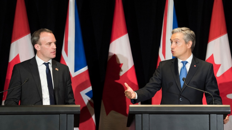 Minister of Foreign Affairs Francois-Philippe Champagne, right, and Dominic Raab the United Kingdom's Foreign Secretary and First Secretary of State speak to reporters following a meeting in Montreal, Thursday, January 9, 2020. THE CANADIAN PRESS/Graham Hughes